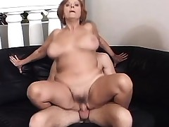 Thick old honey with enormous tits is finger-tickled by big-dicked young stud