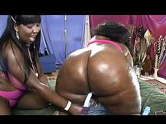 Two lusty black lesbos with fat curvy arses pleasure each other with toys