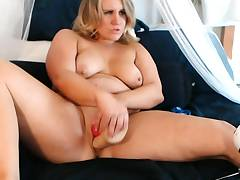 MILF chubby blonde hottie fucks her pussy with a faux-cock