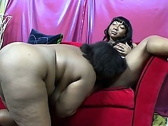 Chunky black lezzies taste each other's picture and share a dildo to reach their climax