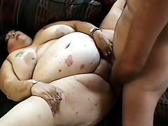 Two wicked mature squealing get their beavers pounded by a well strung up dude